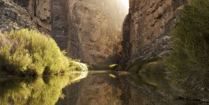 BUYERS-stock-photo-sun-setting-behind-santa-elena-canyon-on-the-rio-grande-river-border-of-united-states-and-mexico-92661133-tea-stained